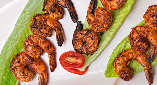 Achiote Shrimp Brochettes over lettuces