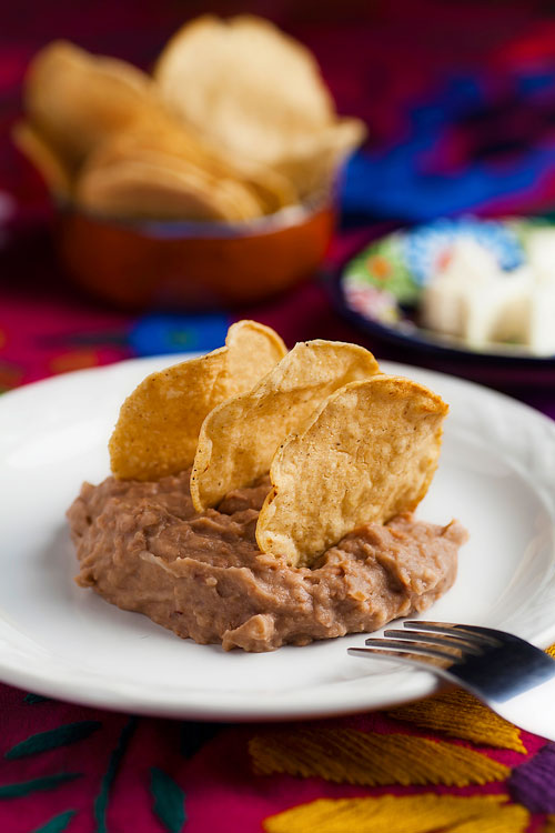 Refried Beans with tortilla chips, cheese and bread
