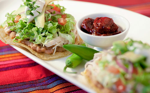 2 Chicken Tostadas over a Mexican tablecloth